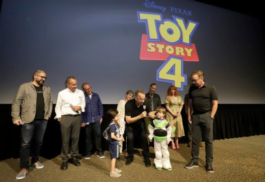 ORLANDO, FLORIDA - JUNE 08: (L-R) Josh Cooley, Jonas Rivera, Mark Nielsen, Annie Potts, Tom Hanks, Tony Hale, Christina Hendricks, Keanu Reeves and Tim Allen surprise fans at an early screening of Pixar's TOY STORY 4 at Disney's Hollywood Studios on June 08, 2019 in Orlando, Florida. (Photo by John Parra/Getty Images for Disney)