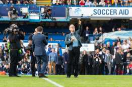 Tom Hanks and Dermot O'Leary at Stamford Bridge, Soccer Aid 2019..Credit : James Gillham /StillMoving.net for Disney