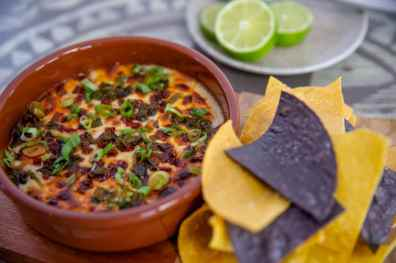 Warm Manchego and Oaxaca Cheese Dip is offered at Three Bridges Bar & Grill in Disney's Coronado Springs Resort at Walt Disney World Resort in Lake Buena Vista, Florida. (Steven Diaz, photographer)