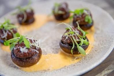 Stuffed Mushrooms filled with plant-based chorizo and smoked tomato aioli is offered at Three Bridges Bar & Grill in Disney's Coronado Springs Resort at Walt Disney World Resort in Lake Buena Vista, Florida. (Steven Diaz, photographer)
