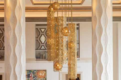 A magnificent chandelier framed by sculpted plaster columns shines in the lobby of Gran Destino Tower above Barcelona Lounge. Gran Destino Tower at Disney's Coronado Springs Resort opens July 9 at Walt Disney World Resort in Lake Buena Vista, Florida. (Steven Diaz, photographer)