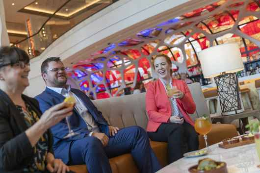 Guests at a preview of Gran Destino Tower at Disney's Coronado Springs Resort enjoy craft beers, select wines and artisanal cocktails in Barcelona Lounge. Gran Destino Tower opens July 9 at Walt Disney World Resort in Lake Buena Vista, Florida. (Steven Diaz, photographer)