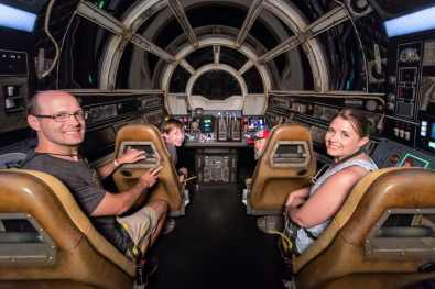 Eight-year-old Jonathan Ridgeway of Ocean Springs, Mississippi (front of attraction, left) becomes the 1 millionth guest to take to take the controls of Millennium Falcon: Smugglers Run at Star Wars: Galaxy's Edge at Disneyland Resort in Anaheim, Calif., Tuesday, July 16, 2019. Front left, clockwise: Jonathan Ridgeway, 8, was joined by his brother Logan Ridgeway, 4, mother Becky Ridgeway and father, Roger Ridgeway. The family was welcomed in the Main Hold of Millennium Falcon with a surprise declaration, which included a visit by Chewbacca, followed by the ride experience and toasting blue and green milk with his family. This significant milestone comes just weeks since the land opened. (Joshua Sudock/Disneyland Resort)