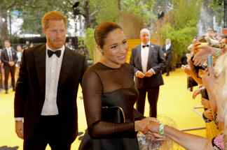 "Harry, Duke of Sussex and Meghan, Duchess of Sussex attend the European Premiere of Disney's ""The Lion King"" at the Odeon Leicester Square on 14th July 2019 in London, UK"
