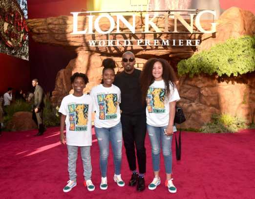 "HOLLYWOOD, CALIFORNIA - JULY 09: Jamie Foxx (C) attends the World Premiere of Disney's ""THE LION KING"" at the Dolby Theatre on July 09, 2019 in Hollywood, California. (Photo by Alberto E. Rodriguez/Getty Images for Disney)"
