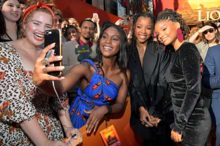 "HOLLYWOOD, CALIFORNIA - JULY 09: Chloe Bailey (C) and Halle Bailey (R) attend the World Premiere of Disney's ""THE LION KING"" at the Dolby Theatre on July 09, 2019 in Hollywood, California. (Photo by Charley Gallay/Getty Images for Disney)"