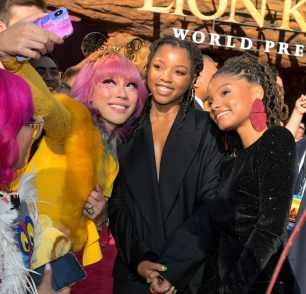 """HOLLYWOOD, CALIFORNIA - JULY 09: Chloe Bailey (C) and Halle Bailey (R) attend the World Premiere of Disney's """"THE LION KING"""" at the Dolby Theatre on July 09, 2019 in Hollywood, California. (Photo by Charley Gallay/Getty Images for Disney)"""