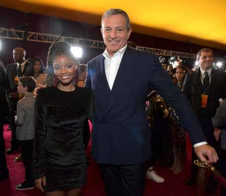 "HOLLYWOOD, CALIFORNIA - JULY 09: Halle Bailey and The Walt Disney Company Chairman and CEO Bob Iger attend the World Premiere of Disney's ""THE LION KING"" at the Dolby Theatre on July 09, 2019 in Hollywood, California. (Photo by Charley Gallay/Getty Images for Disney)"