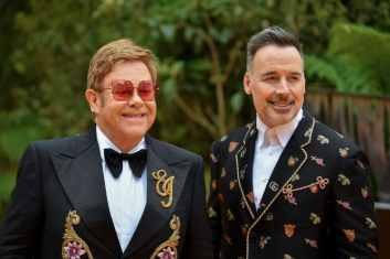 """LONDON, ENGLAND - JULY 14: Sir Elton John and David Furnish attend the European Premiere of Disney's """"The Lion King"""" at Odeon Luxe Leicester Square on July 14, 2019 in London, England. (Photo by Gareth Cattermole/Getty Images for Disney)"""