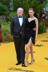 """LONDON, ENGLAND - JULY 14: Hans Zimmer and Zoe Zimmer attend the European Premiere of Disney's """"The Lion King"""" at Odeon Luxe Leicester Square on July 14, 2019 in London, England. (Photo by Gareth Cattermole/Getty Images for Disney)"""