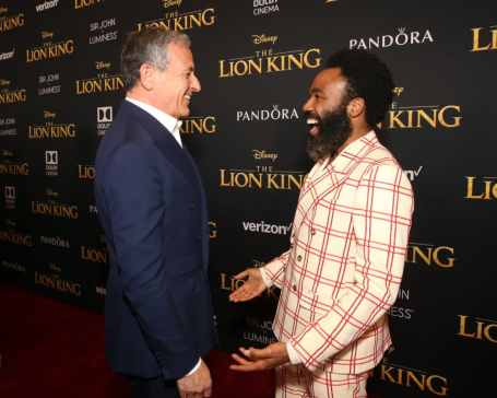 "HOLLYWOOD, CALIFORNIA - JULY 09: The Walt Disney Company Chairman and CEO Bob Iger (L) and Donald Glover attend the World Premiere of Disney's ""THE LION KING"" at the Dolby Theatre on July 09, 2019 in Hollywood, California. (Photo by Jesse Grant/Getty Images for Disney)"