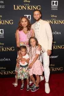 "HOLLYWOOD, CALIFORNIA - JULY 09: (L-R) Ryan Curry, Ayesha Curry, Riley Curry, and Stephen Curry attend the World Premiere of Disney's ""THE LION KING"" at the Dolby Theatre on July 09, 2019 in Hollywood, California. (Photo by Jesse Grant/Getty Images for Disney)"