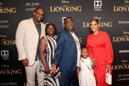 "HOLLYWOOD, CALIFORNIA - JULY 09: (C -R) Tracy Morgan, Maven Sonae Morgan, and Megan Wollover attend the World Premiere of Disney's ""THE LION KING"" at the Dolby Theatre on July 09, 2019 in Hollywood, California. (Photo by Jesse Grant/Getty Images for Disney)"