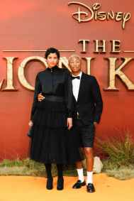 """Helen Lasichanh and Pharrell Williams attend the European Premiere of Disney's """"The Lion King"""" at the Odeon Leicester Square on 14th July 2019 in London, UK"""