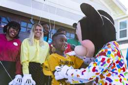 Seven-year-old Jermaine Bell gets the surprise of a lifetime when Mickey Mouse shows up at his birthday party Sept 8, 2019, in Kissimmee, Fla. Mickey and Walt Disney World cast members were there to honor Jermaine who used money he'd saved for a Walt Disney World vacation to feed people fleeing Hurricane Dorian. Adding to a day filled with surprises, Jermaine learned that he and his family will be guests of Disney for a VIP getaway to the vacation kingdom later this month. (Disney)