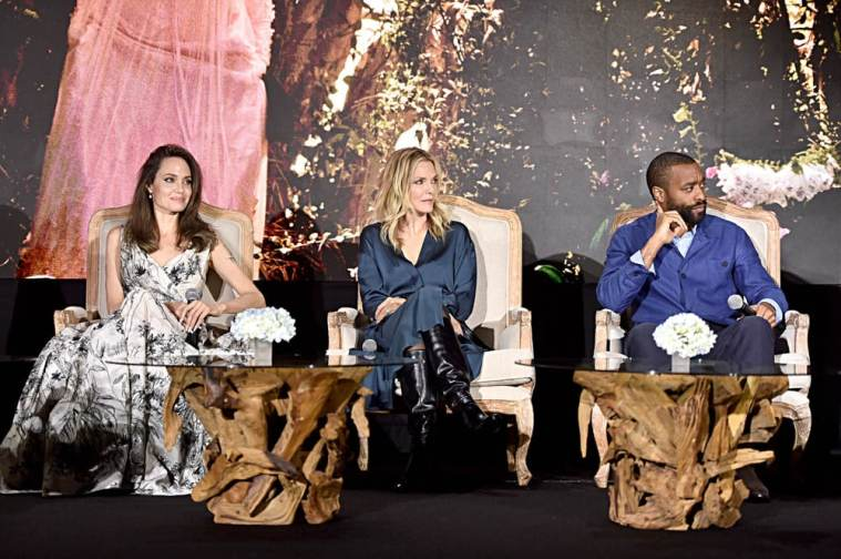 """BEVERLY HILLS, CALIFORNIA - SEPTEMBER 30: (L-R) Actors Angelina Jolie, Michelle Pfeiffer and Chiwetel Ejiofor participate in the global press conference for """"Disney's Maleficent: Mistress of Evil"""" on September 30, 2019 in Beverly Hills, California. (Photo by Alberto E. Rodriguez/Getty Images for Disney)"""