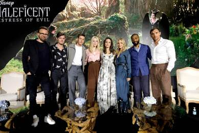 """BEVERLY HILLS, CALIFORNIA - SEPTEMBER 30: (L-R) Director Joachim Ronning, actors Sam Riley, Harris Dickinson, Elle Fanning, Angelina Jolie, Michelle Pfeiffer, Chiwetel Ejiofor and Ed Skrein participate in the global press conference for """"Disney's Maleficent: Mistress of Evil"""" on September 30, 2019 in Beverly Hills, California. (Photo by Alberto E. Rodriguez/Getty Images for Disney)"""