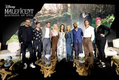 """BEVERLY HILLS, CALIFORNIA - SEPTEMBER 30: (L-R) Director Joachim Ronning, actors Sam Riley, Harris Dickinson, Elle Fanning, Angelina Jolie, Michelle Pfeiffer, Chiwetel Ejiofor, Ed Skrein and moderator Grae Drake participate in the global press conference for """"Disney's Maleficent: Mistress of Evil"""" on September 30, 2019 in Beverly Hills, California. (Photo by Alberto E. Rodriguez/Getty Images for Disney)"""