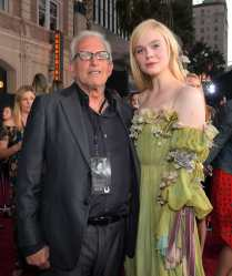 """HOLLYWOOD, CALIFORNIA - SEPTEMBER 30: (L-R) Producer Joe Roth and Actor Elle Fanning attend the World Premiere of Disney's """"Maleficent: Mistress of Evil"""" at the El Capitan Theatre on September 30, 2019 in Hollywood, California. (Photo by Charley Gallay/Getty Images for Disney)"""