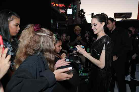 "Angelina Jolie signs autographs for fans at the World Premiere of Disney's ""Maleficent: Mistress of Evil"" at the El Capitan Theatre in Hollywood, CA on September 30, 2019 (photo: Alex J. Berliner/ABImages)"