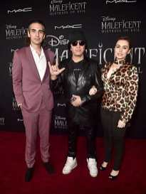 "HOLLYWOOD, CALIFORNIA - SEPTEMBER 30: (L-R) Nick Simmons, Gene Simmons, and Sophie Simmons attend the World Premiere of Disney's ""Maleficent: Mistress of Evil"" at the El Capitan Theatre on September 30, 2019 in Hollywood, California. (Photo by Alberto E. Rodriguez/Getty Images for Disney)"