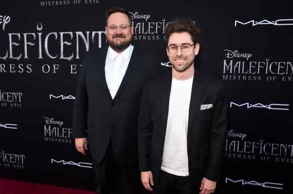 """HOLLYWOOD, CALIFORNIA - SEPTEMBER 30: (L-R) Co-screenwriters Noah Harpster and Micah Fitzerman-Blue attend the World Premiere of Disney's """"Maleficent: Mistress of Evil"""" at the El Capitan Theatre on September 30, 2019 in Hollywood, California. (Photo by Alberto E. Rodriguez/Getty Images for Disney)"""