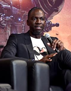 "HOLLYWOOD, CALIFORNIA - NOVEMBER 13: Rick Famuyiwa speaks onstage at the premiere of Lucasfilm's first-ever, live-action series, ""The Mandalorian,"" at the El Capitan Theatre in Hollywood, Calif. on November 13, 2019. ""The Mandalorian"" streams exclusively on Disney+. (Photo by Alberto E. Rodriguez/Getty Images for Disney)"