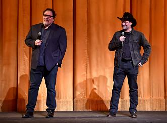 "HOLLYWOOD, CALIFORNIA - NOVEMBER 13: (L-R) Executive Producer Jon Favreau and Executive Producer/Director Dave Filoni speak onstage at the premiere of Lucasfilm's first-ever, live-action series, ""The Mandalorian,"" at the El Capitan Theatre in Hollywood, Calif. on November 13, 2019. ""The Mandalorian"" streams exclusively on Disney+. (Photo by Alberto E. Rodriguez/Getty Images for Disney)"
