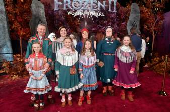 """HOLLYWOOD, CALIFORNIA - NOVEMBER 07: Per Olof Nutti (2nd from L) and guests attend the world premiere of Disney's """"Frozen 2"""" at Hollywood's Dolby Theatre on Thursday, November 7, 2019 in Hollywood, California. (Photo by Alberto E. Rodriguez/Getty Images for Disney)"""