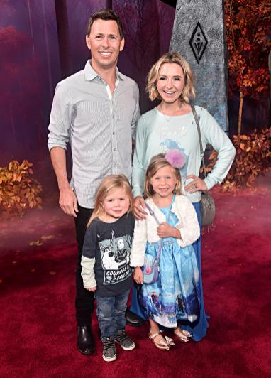 """HOLLYWOOD, CALIFORNIA - NOVEMBER 07: (L-R) Michael Cameron, Hutton Michael Cameron, Kenzie Cameron, and Beverley Mitchell attend the world premiere of Disney's """"Frozen 2"""" at Hollywood's Dolby Theatre on Thursday, November 7, 2019 in Hollywood, California. (Photo by Alberto E. Rodriguez/Getty Images for Disney)"""