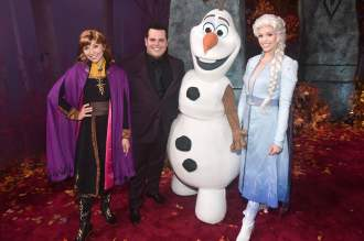"HOLLYWOOD, CALIFORNIA - NOVEMBER 07: (L-R) Anna, Actor Josh Gad, Olaf, and Elsa attend the world premiere of Disney's ""Frozen 2"" at Hollywood's Dolby Theatre on Thursday, November 7, 2019 in Hollywood, California. (Photo by Alberto E. Rodriguez/Getty Images for Disney)"