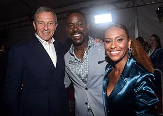 "HOLLYWOOD, CALIFORNIA - NOVEMBER 07: (L-R) The Walt Disney Company Chairman and CEO Bob Iger, Actor Sterling K. Brown, and Ryan Michelle Bathe attends the world premiere of Disney's ""Frozen 2"" at Hollywood's Dolby Theatre on Thursday, November 7, 2019 in Hollywood, California. (Photo by Alberto E. Rodriguez/Getty Images for Disney)"