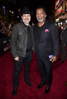 "HOLLYWOOD, CALIFORNIA - NOVEMBER 13: Executive producer/director Dave Filoni and Carl Weathers arrive at the premiere of Lucasfilm's first-ever, live-action series, ""The Mandalorian,"" at the El Capitan Theatre in Hollywood, Calif. on November 13, 2019. ""The Mandalorian"" streams exclusively on Disney+. (Photo by Alberto E. Rodriguez/Getty Images for Disney)"
