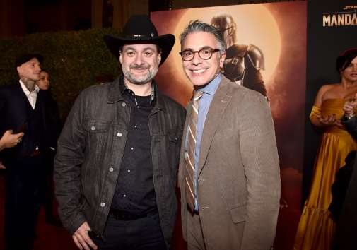"HOLLYWOOD, CALIFORNIA - NOVEMBER 13: (L-R) Executive Producer/Director Dave Filoni and President, Content and Marketing for Disney+ Ricky Strauss arrive at the premiere of Lucasfilm's first-ever, live-action series, ""The Mandalorian,"" at the El Capitan Theatre in Hollywood, Calif. on November 13, 2019. ""The Mandalorian"" streams exclusively on Disney+. (Photo by Alberto E. Rodriguez/Getty Images for Disney)"
