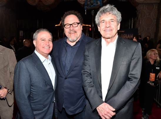 "HOLLYWOOD, CALIFORNIA - NOVEMBER 13: (L-R) Co-Chairman, The Walt Disney Studios Alan Bergman, Executive Producer Jon Favreau and Co-Chairman and Chief Creative Officer of The Walt Disney Studios Alan Horn arrive at the premiere of Lucasfilm's first-ever, live-action series, ""The Mandalorian,"" at the El Capitan Theatre in Hollywood, Calif. on November 13, 2019. ""The Mandalorian"" streams exclusively on Disney+. (Photo by Alberto E. Rodriguez/Getty Images for Disney)"