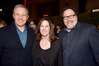"HOLLYWOOD, CALIFORNIA - NOVEMBER 13: (L-R) Disney CEO Bob Iger, Executive Producer Kathleen Kennedy and Executive Producer Jon Favreau arrive at the premiere of Lucasfilm's first-ever, live-action series, ""The Mandalorian,"" at the El Capitan Theatre in Hollywood, Calif. on November 13, 2019. ""The Mandalorian"" streams exclusively on Disney+. (Photo by Alberto E. Rodriguez/Getty Images for Disney)"