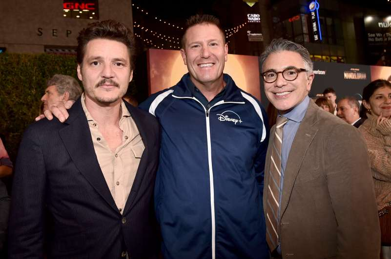 "HOLLYWOOD, CALIFORNIA - NOVEMBER 13: (L-R) Pedro Pascal, Chairman of Direct-to-Consumer & International division of The Walt Disney Company Kevin Mayer and President, Content and Marketing for Disney+ Ricky Strauss arrive at the premiere of Lucasfilm's first-ever, live-action series, ""The Mandalorian,"" at the El Capitan Theatre in Hollywood, Calif. on November 13, 2019. ""The Mandalorian"" streams exclusively on Disney+. (Photo by Alberto E. Rodriguez/Getty Images for Disney)"