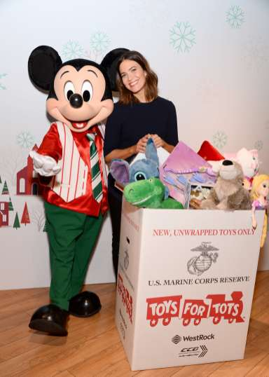 GLENDALE, CALIFORNIA - OCTOBER 28: Mandy Moore with U.S. Marines and Holiday Mickey kick off shopDisney.com| Disney store's Holiday campaign at Glendale Galleria Disney store. Starting today, November 2 through December 15, for every new, unwrapped toy donated at a Disney store in the U.S. or online through shopDisney.com, Disney will donate $1 to Toys for Tots (toysfortots.org). (Photo by Andrew Toth/Getty Images for Disney)