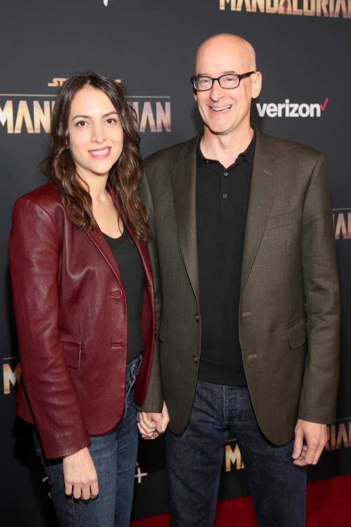"HOLLYWOOD, CALIFORNIA - NOVEMBER 13: Peyton Reed (R) and guest arrive at the premiere of Lucasfilm's first-ever, live-action series, ""The Mandalorian,"" at the El Capitan Theatre in Hollywood, Calif. on November 13, 2019. ""The Mandalorian"" streams exclusively on Disney+. (Photo by Jesse Grant/Getty Images for Disney)"