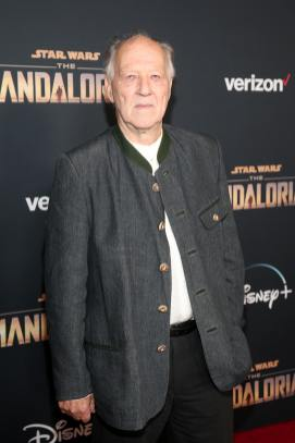 "HOLLYWOOD, CALIFORNIA - NOVEMBER 13: Werner Herzog arrives at the premiere of Lucasfilm's first-ever, live-action series, ""The Mandalorian,"" at the El Capitan Theatre in Hollywood, Calif. on November 13, 2019. ""The Mandalorian"" streams exclusively on Disney+. (Photo by Jesse Grant/Getty Images for Disney)"