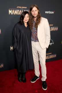 "HOLLYWOOD, CALIFORNIA - NOVEMBER 13: (L-R) Serena McKinney and Composer Ludwig Göransson arrive at the premiere of Lucasfilm's first-ever, live-action series, ""The Mandalorian,"" at the El Capitan Theatre in Hollywood, Calif. on November 13, 2019. ""The Mandalorian"" streams exclusively on Disney+. (Photo by Jesse Grant/Getty Images for Disney)"