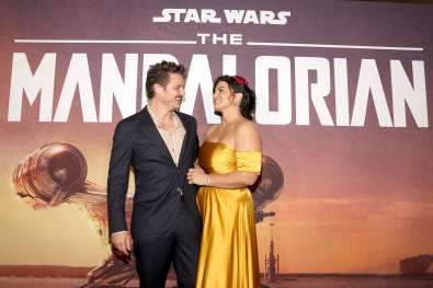"HOLLYWOOD, CALIFORNIA - NOVEMBER 13: Pedro Pascal and Gina Carano arrive at the premiere of Lucasfilm's first-ever, live-action series, ""The Mandalorian,"" at the El Capitan Theatre in Hollywood, Calif. on November 13, 2019. ""The Mandalorian"" streams exclusively on Disney+. (Photo by Jesse Grant/Getty Images for Disney)"