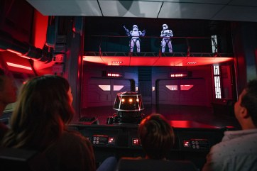 Guests flee First Order Stormtroopers onboard a Star Destroyer as part of Star Wars: Rise of the Resistance, the groundbreaking new attraction opening Dec. 5, 2019, inside Star Wars: Galaxy's Edge at Disney's Hollywood Studios in Florida and Jan. 17, 2020, at Disneyland Park in California. (Matt Stroshane, photographer)