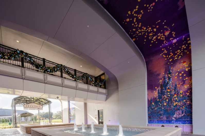 """Part of the unique artwork at this resort are the two mosaic murals in the arched tunnel which lead to the nearby Disney Skyliner station. One mural shows London at night, with Peter Pan, Wendy, Michael and John flying off to Neverland and the other shows Rapunzel's floating lantern scene from """"Tangled."""" (Steven Diaz, photographer)"""