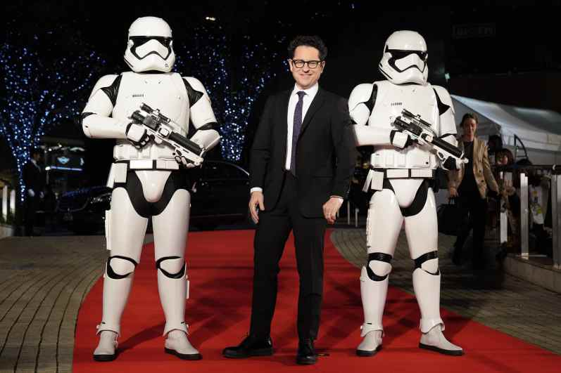 TOKYO, JAPAN - DECEMBER 11: Director J.J. Abrams with Stormtroopers attends the special fan event for 'Star Wars: The Rise of Skywalker' at Roppongi Hills on December 11, 2019 in Tokyo, Japan. (Photo by Christopher Jue/Getty Images for Disney)