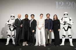 TOKYO, JAPAN - DECEMBER 11: (L-R) Anthony Daniels, John Boyega, J.J. Abrams, Daisy Ridley, Oscar Isaac and Katherine Kennedy with Star Wars characters Stormtrooper pose on stage at the special fan event for 'Star Wars: The Rise of Skywalker' at Roppongi Hills on December 11, 2019 in Tokyo, Japan. (Photo by Christopher Jue/Getty Images for Disney)