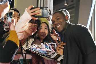 TOKYO, JAPAN - DECEMBER 11: John Boyega signs autographs for fans the special fan event for 'Star Wars: The Rise of Skywalker' at Roppongi Hills on December 11, 2019 in Tokyo, Japan. (Photo by Christopher Jue/Getty Images for Disney)