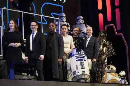 TOKYO, JAPAN - DECEMBER 11: (L-R) Katherine Kennedy, J.J. Abrams, John Boyega, Daisy Ridley, Oscar Isaac and Anthony Daniels with Star Wars characters Stormtroopers, Kylo Ren, R2-D2, C-3PO, BB-8 and D-O pose for photos at the special fan event for 'Star Wars: The Rise of Skywalker' the special fan event for 'Star Wars: The Rise of Skywalker' at Roppongi Hills on December 11, 2019 in Tokyo, Japan. (Photo by Christopher Jue/Getty Images for Disney)