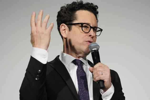 TOKYO, JAPAN - DECEMBER 11: Director J.J. Abrams speaks on stage at the special fan event for 'Star Wars: The Rise of Skywalker' at Roppongi Hills on December 11, 2019 in Tokyo, Japan. (Photo by Christopher Jue/Getty Images for Disney)