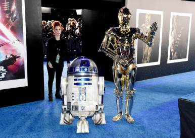 "HOLLYWOOD, CALIFORNIA - DECEMBER 16: (L-R) R2-D2 and C-3PO arrive for the World Premiere of ""Star Wars: The Rise of Skywalker"", the highly anticipated conclusion of the Skywalker saga on December 16, 2019 in Hollywood, California. (Photo by Alberto E. Rodriguez/Getty Images for Disney)"